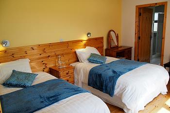 Comfortable ensuite bedrooms with 2 small double beds each