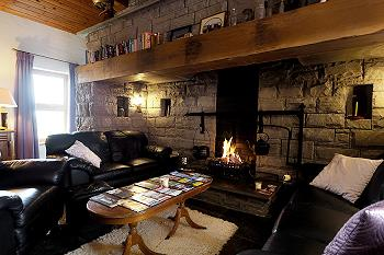 Comfortable leather furniture; open fire place